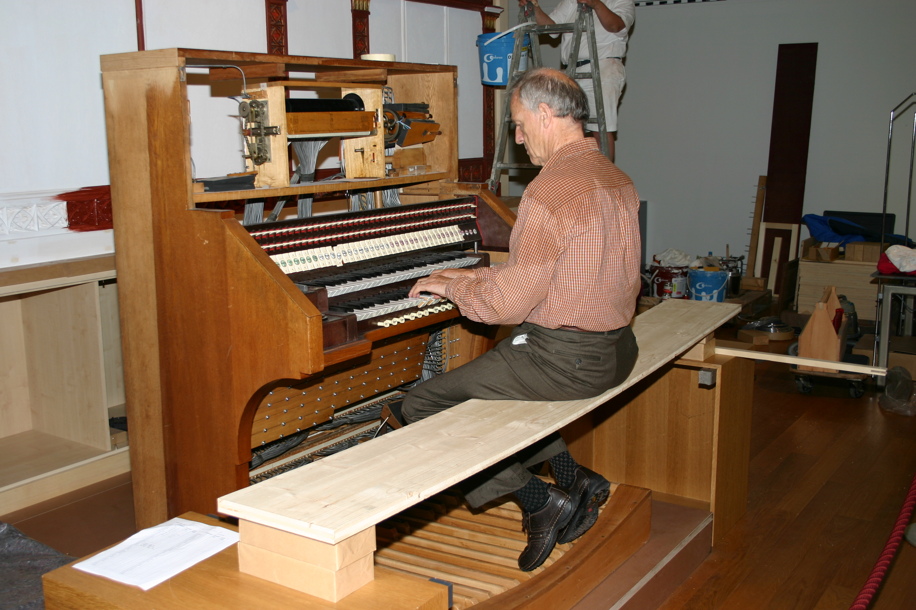 David Rumsey testing the organ during its rebuild
